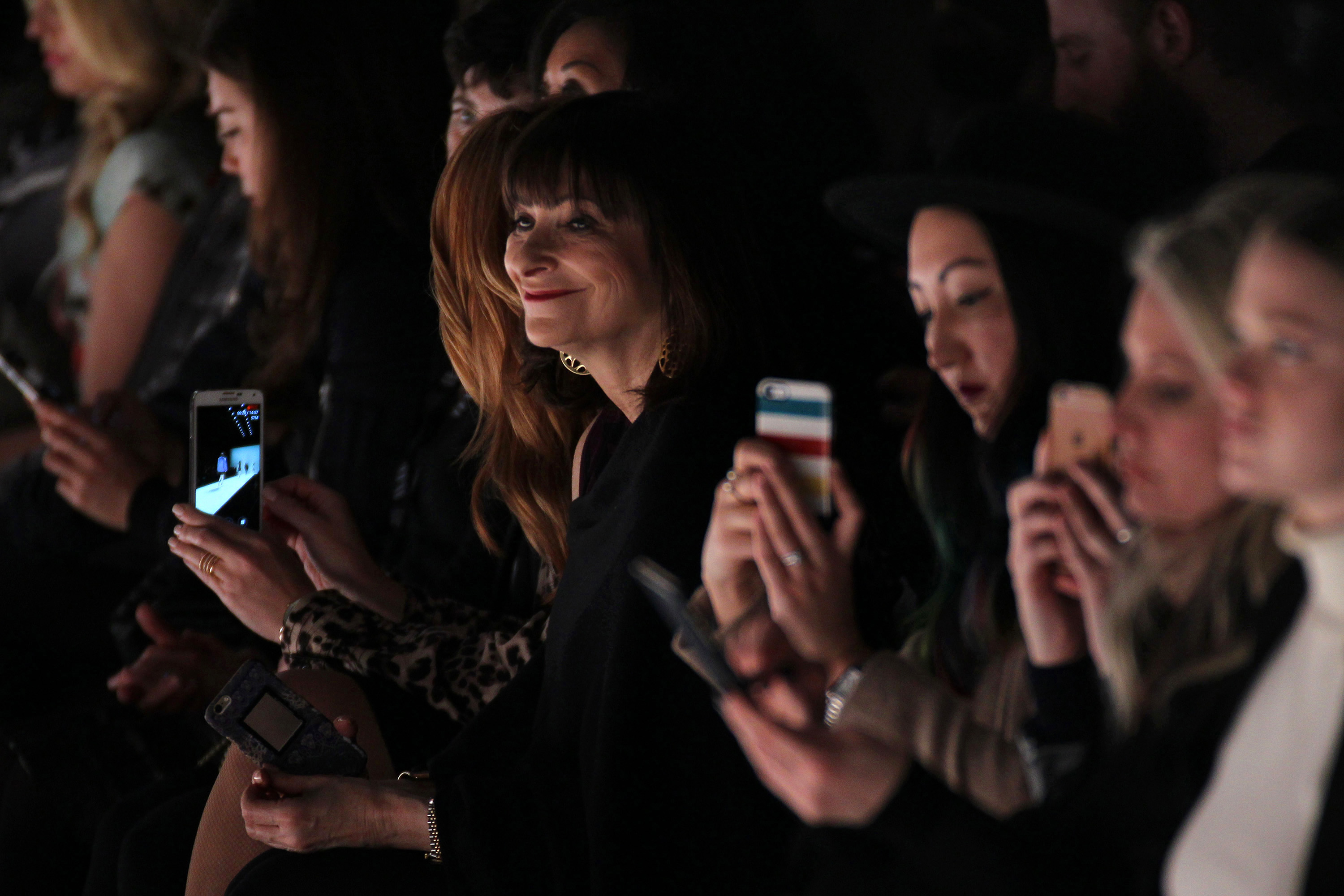 TORONTO, ON - MARCH 16:  Jeanne Beker takes a picture for social media during the Jennifer Torosian fashion show at David Pecaut Square on March 16, 2016 in Toronto, Canada.  (Photo by Edward James/FilmMagic)