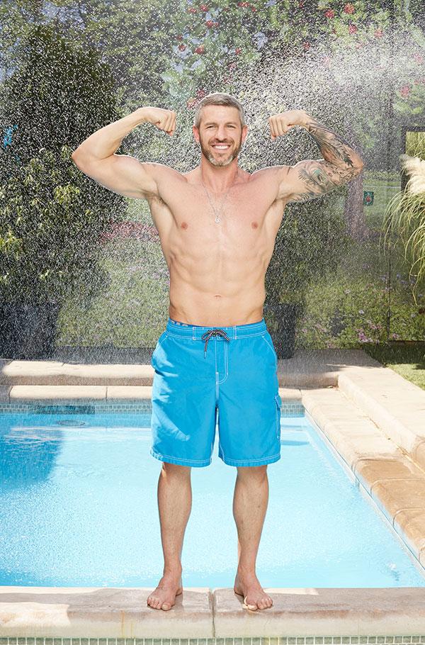 Matthew Clines flexes his bulging biceps.
